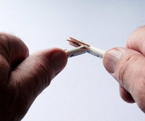man's hands snapping a pencil